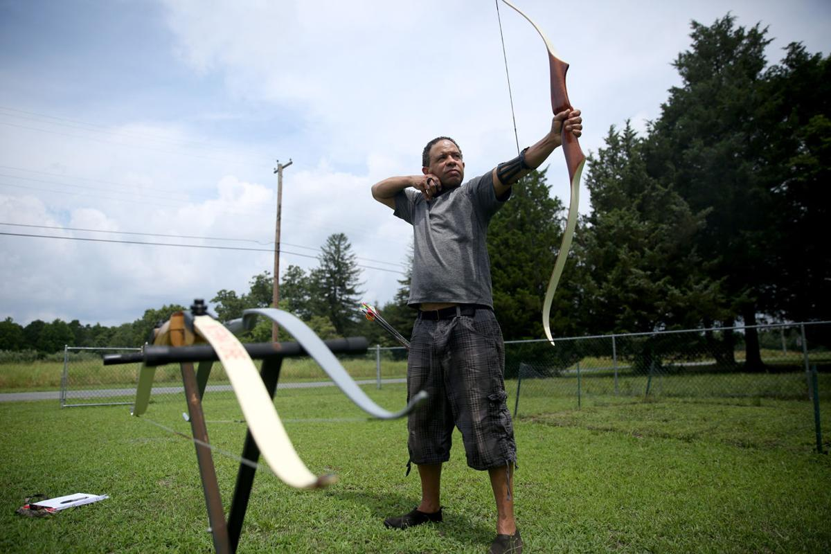 press graphic artist constructs archery range in his backyard