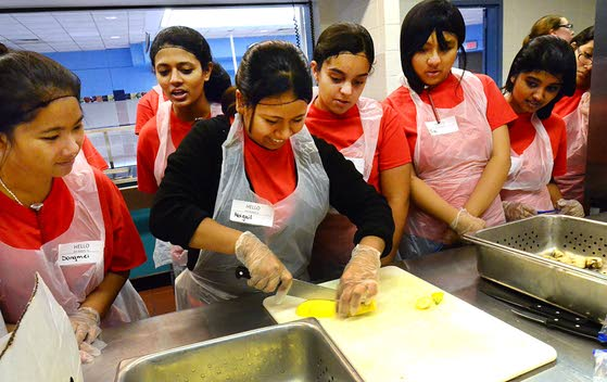 Teaming up to make mealsChefs, students work together to help feed the needy