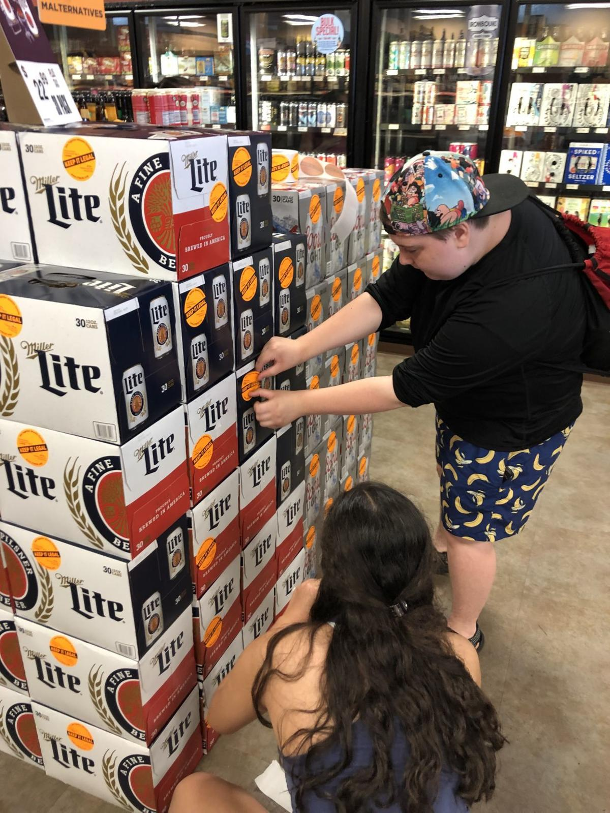 Students sticker liquor for substance abuse awareness