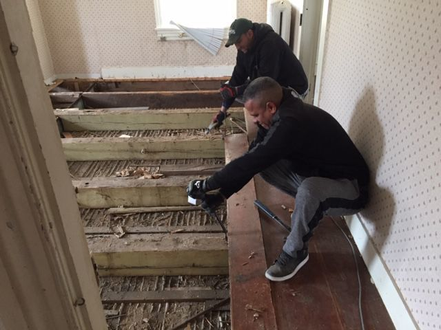 Salvaging floorboards from 310 Cape Ave. in Cape May Point