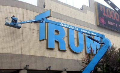 Trump name comes down