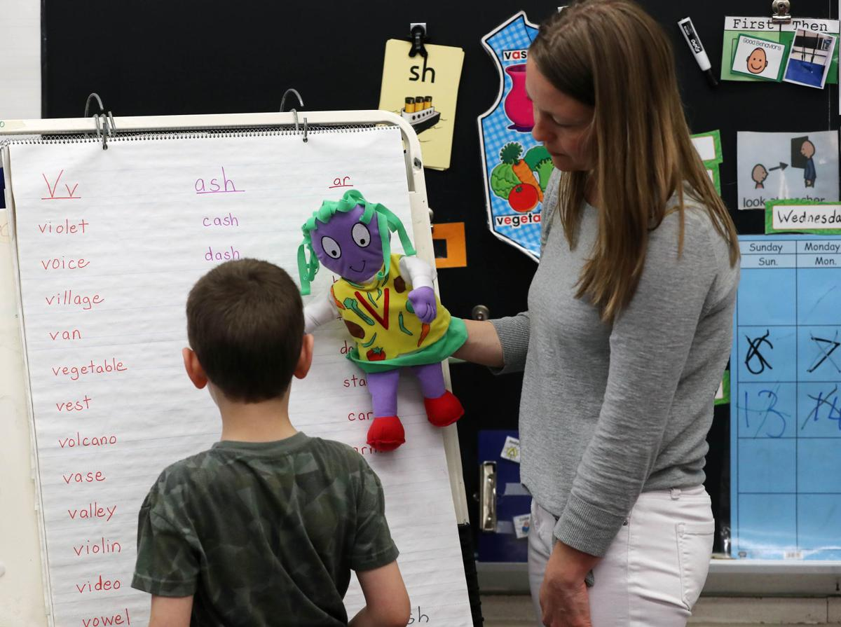 Teacher interacting with students during special education program