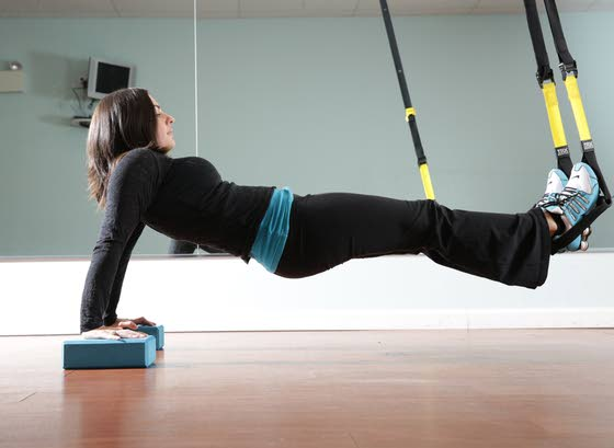 Your workout: Hip lifts into reverse plank on yoga blocks