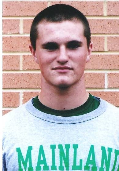 In the huddle with Mainland Regional kicker Jim Cooper