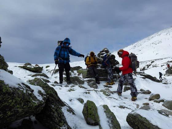Adventurous Boy Scout troop members trek close to the top of Mt. Washington