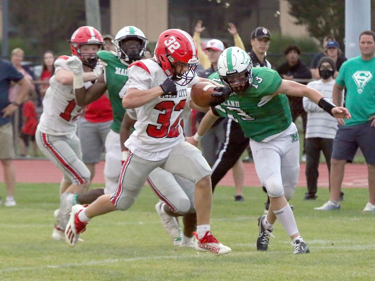 Main football photo for B1 for Saturday, Sept. 18