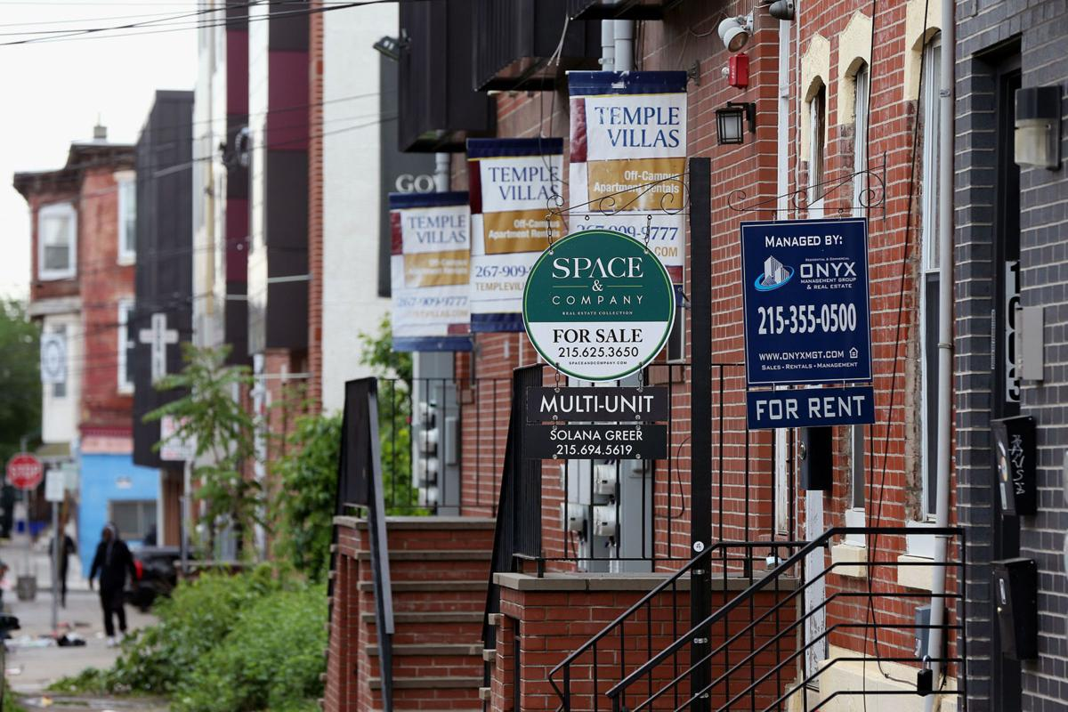 Property management signs advertise student housing for rent on Willington Street near West Oxford Street, a neighborhood adjacent to Temple University in North Philadelphia.