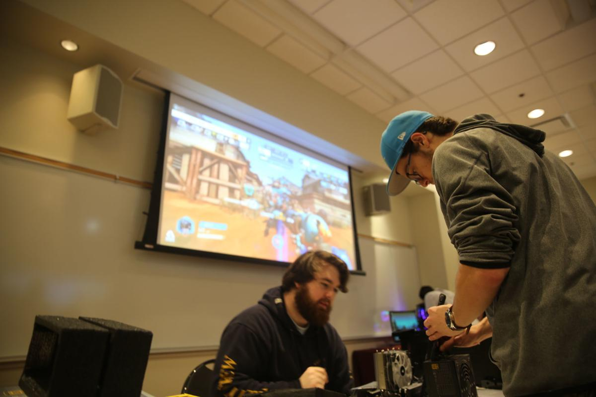 Stockton students build a computer for the new e-sports lab.