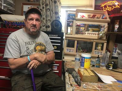 When he picks up a hammer, the shaking stops. N.C. man with Parkinson's builds mini homes.