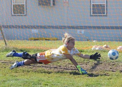 1b2e3f2ba High school girls soccer team-by-team previews and more. Millville goalie  Julia Limbeck works the ...