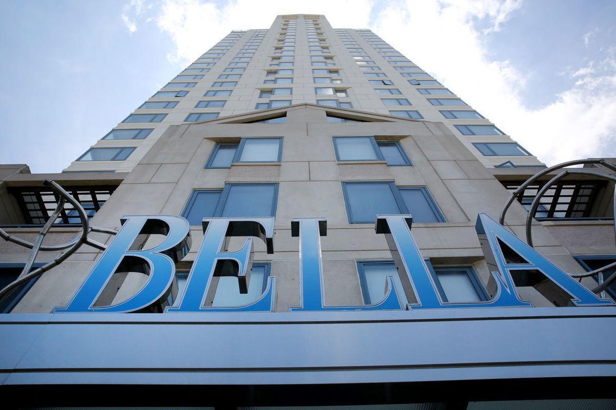 Bella Sign Looking Up Building.jpg