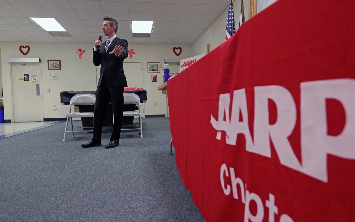 Joe Martucci speaking at an AARP Meeting