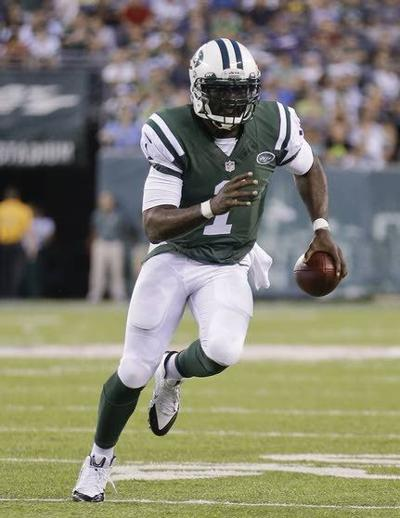 64609072d03 Jets quarterback Michael Vick looks for yardage during a 13-10 preseason  win against the Colts on Friday night in East Rutherford.