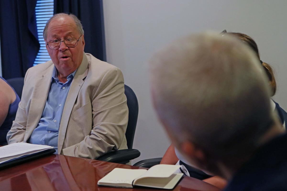 School officials talk with Senator Van Drew