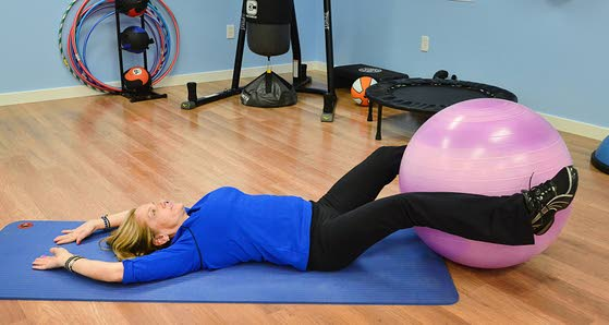 Your Workout: Sit up with resistance ball