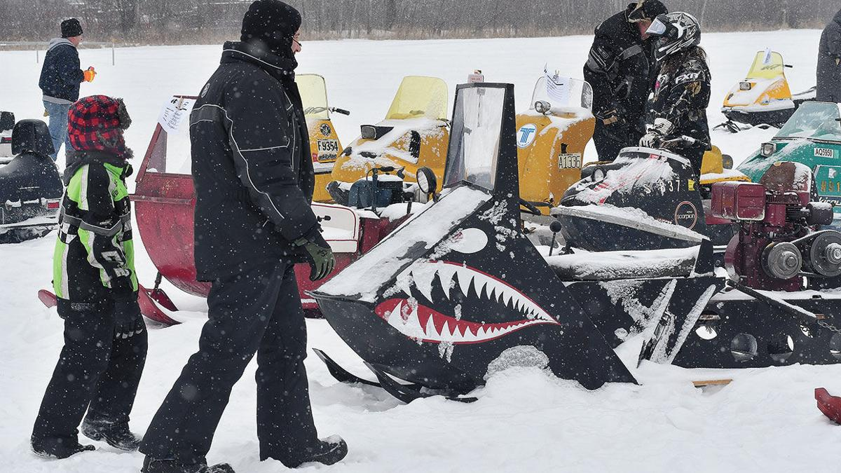 Hardy riders brave the cold and snow on vintage sleds