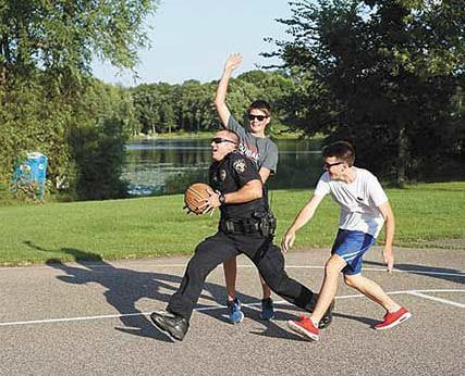 Officers-play-basketball-at-Golden-Lake-Park.jpg