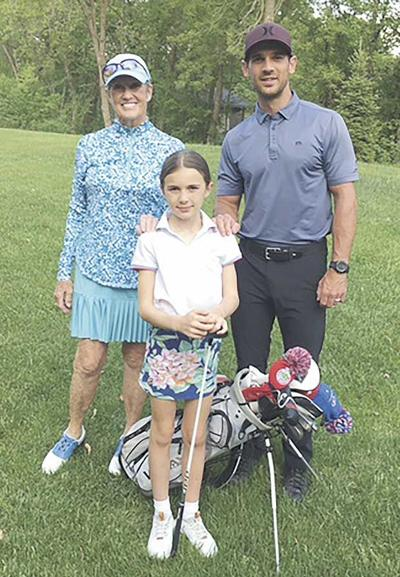 Young golfer takes it all in stride