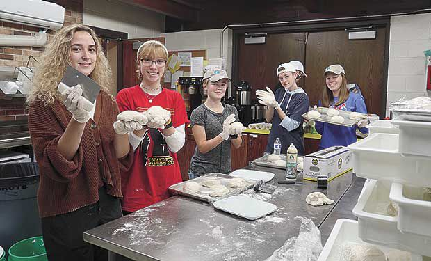 Church fires up brick oven for good of community