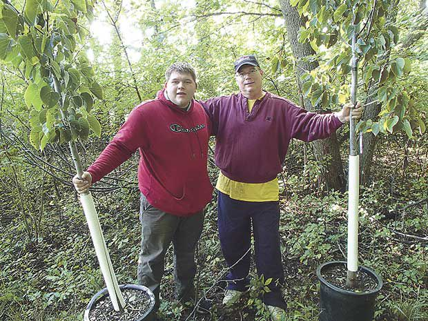 Peltier-Island-tree-planting-2019-John-and-Brian-Bourassa.jpg