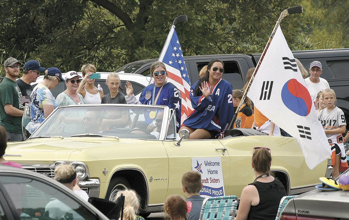 Olympians get warm Heritage Days welcome home