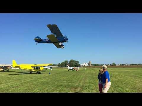 Biplane lands at Osceola airport