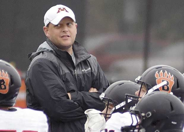 Bears football coach back on job while battling cancer
