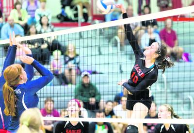 Beekmantown's Grace Kelly spikes the ball