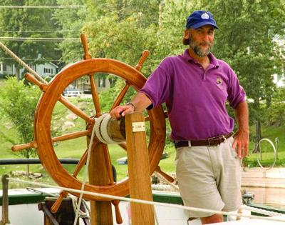 Art Cohn at the wheel of the schooner Lois McClure