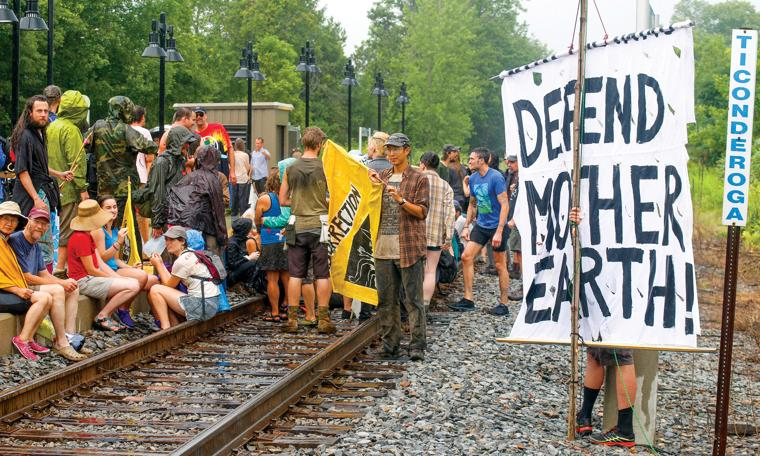 Protestors Protestors from a consortium of environmental groups block the tracks at the Ticonderoga Amtrak Train Station in opposition to crude-oil trains that travel through there. They sat on the rails for 47 minutes to honor the 47 victims of the 2013 Quebec rail disaster.