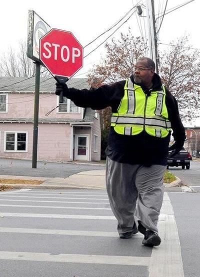Crossing guard on leave after striking student