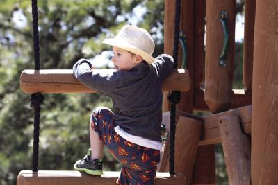 Boy scales playground ladder in single bound