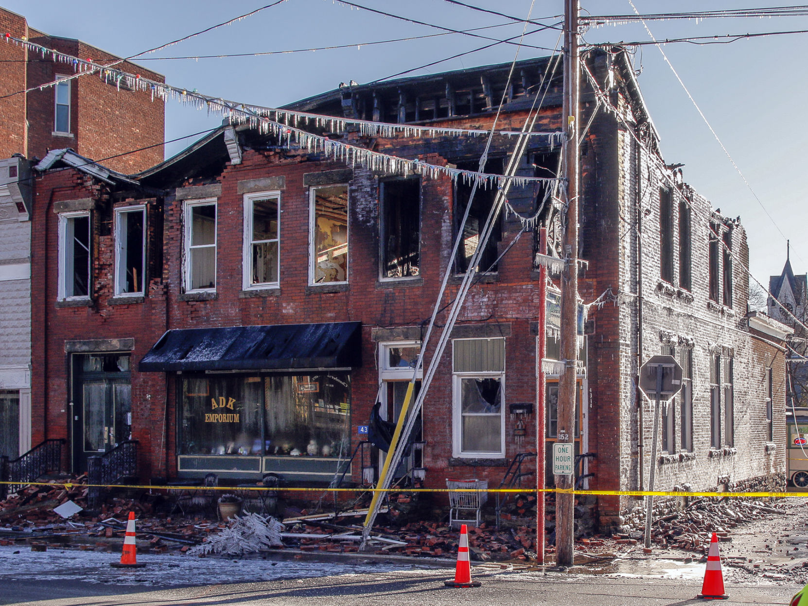 The Building At The Corner Of Main Street And St. Patricku0027s Place, With Its  Roof Mostly Caved In, Is Off Limits Except To Fire Investigators The Day  After A ...