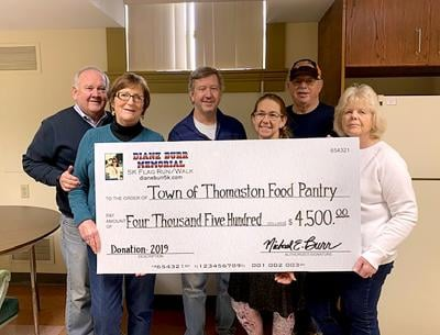 COMMITTEE DONATES TO FOOD PANTRY