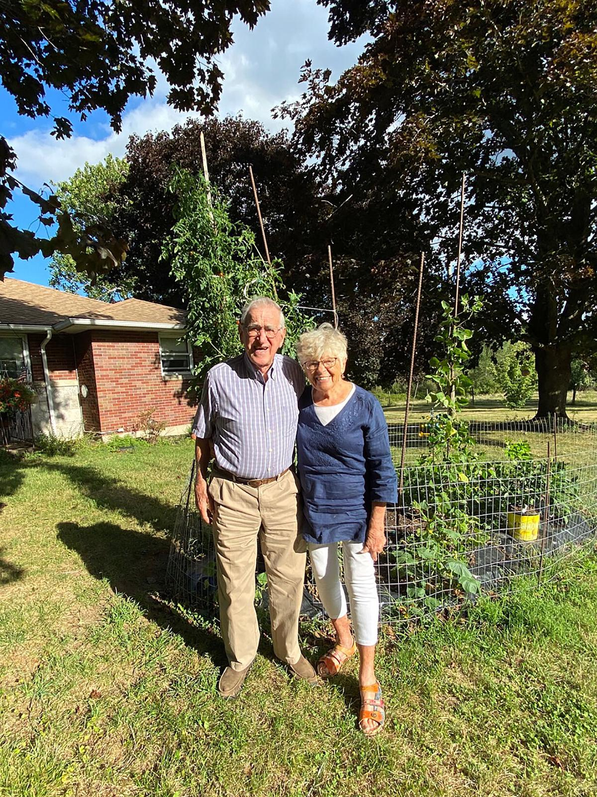 Watertown Gardeners Grow 10-Foot Tall Tomato Plants in Backyard