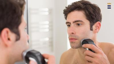 If your hair is longer, it's best to trim it down to a shorter length prior to using an electric razor. This will stop the razor from pulling hairs, which can contribute to irritation.