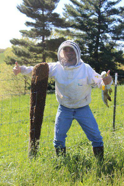 Beekeeper Lambert gives a thumbs up