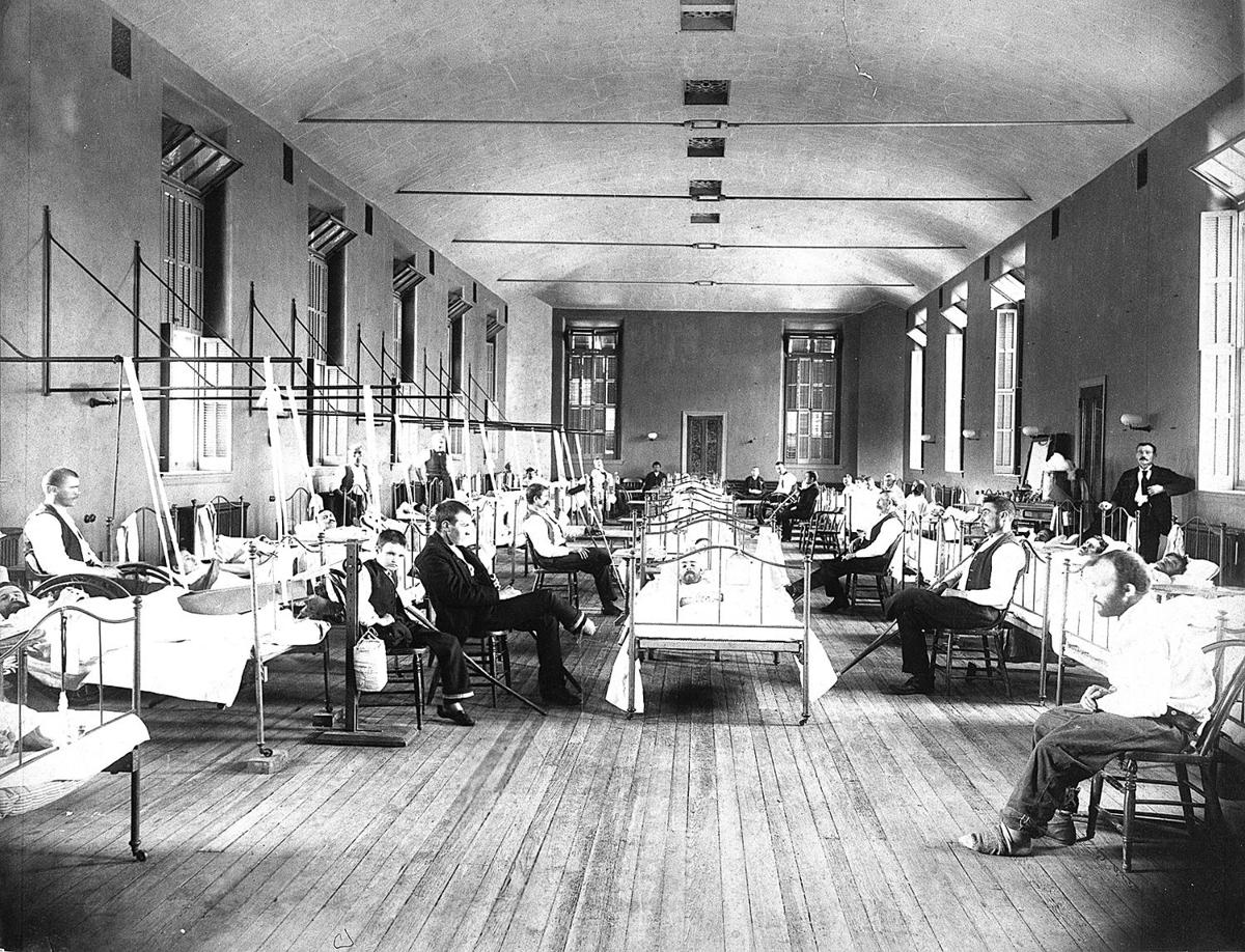 A crowded ward in the Welch miners hospital.