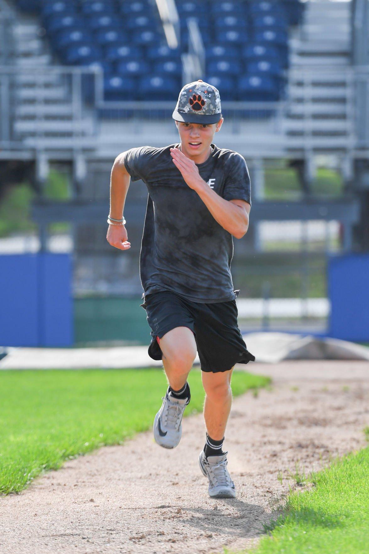 PSHS Baseball-hustle to first.jpg