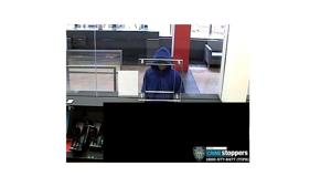 Robber hits up bank in Jackson Heights 1