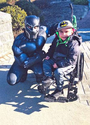Superheroes treat the kids at St. Mary's 1
