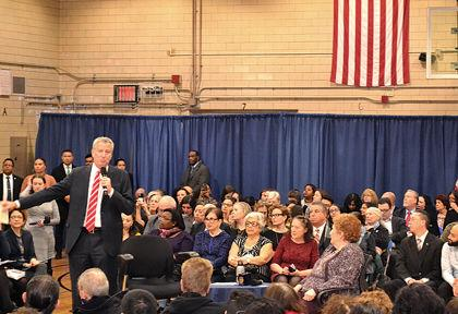 www.qchron.com: Mayor defends his positions at crowded town hall