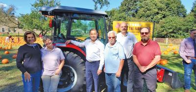 Co-op donates tractor to farm neighbors 1