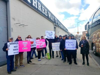 Astorians opposing rezoning rally at site and officials' offices, but in vain 1