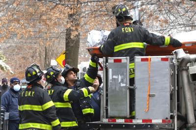 Troubled building burns, killing three 1
