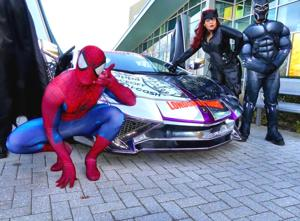 Superheroes treat the kids at St. Mary's 2