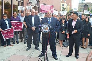 <p>Metropolitan Package Store Association Executive Director Michael Correra speaks at a rally in Downtown Flushing on Monday evening against the proposed Total Wine &amp; More location at 30-02 Whitestone Expwy. in College Point.</p>