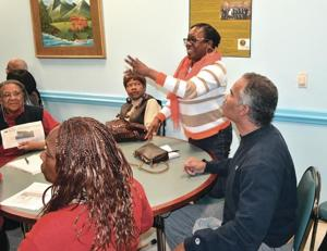 <p>Resident Lucy Calomathi of Cambria Heights said she and her neighbors have had no end of inconvenience and disrespect from membrs of Ohel Chabad Lubavitch. She spoke out Monday night against an application the group has filed to build a four-story synagogue and community center near its existing facilities on Francis Lewis Boulevard.</p>
