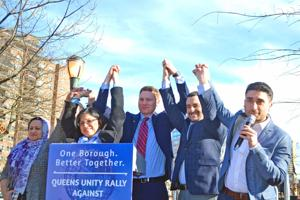<p>Mazeda Uddin of the South Asian Fund for Education, Scholarship and Training, left, and event organizers Irina Kimyagar, Ethan Felder, Jeff Kohn and David Aronov after last Sunday's rally against anti-Semitism at MacDonald Park in Forest Hills.</p>