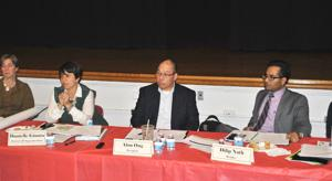 <p>District 26 Superintendent Danielle Giunta and Community Education Council 26 President Alan Ong listen to public comments about a proposed rezoning of five district schools in response to the creation of a new one in Bayside.</p>